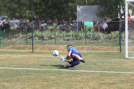 ODESSA, UKRAINE - Fight of the first league football clubs at the Ukrainian championship. FC BALKANY (Zorya) - FC VOLYNB (Lutsk) - red. A dramatic duel while playing big football on a grass field Foto de archivo - 151901179