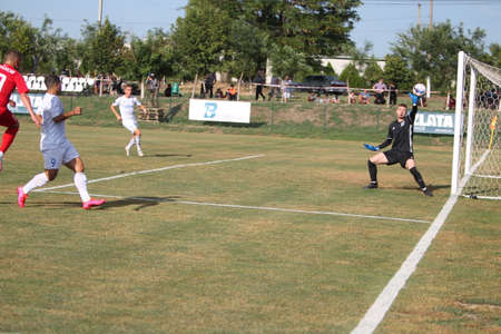 ODESSA, UKRAINE - Fight of the first league football clubs at the Ukrainian championship. FC BALKANY (Zorya) - FC VOLYNB (Lutsk) - red. A dramatic duel while playing big football on a grass field Foto de archivo - 151901183