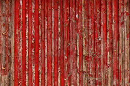 Abstract Background of old painted wood. Wooden fence with traces of old cracked faded paint on the wood surface Foto de archivo