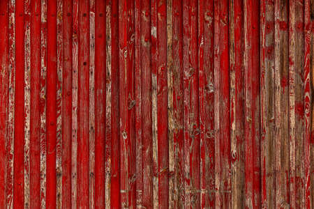 Abstract Background of old painted wood. Wooden fence with traces of old cracked faded paint on the wood surface Foto de archivo - 151912307