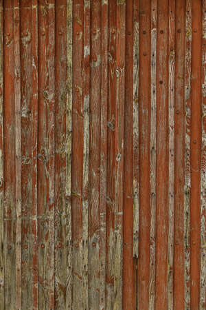 Abstract Background of old painted wood. Wooden fence with traces of old cracked faded paint on the wood surface Foto de archivo - 151912364