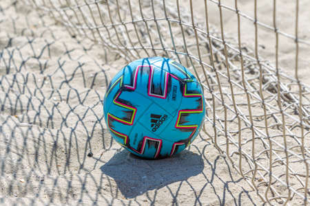 Odessa, Ukraine-July 25, 2020: Beach Soccer Championship among amateur women on beach. Soccer in sand. Young beautiful girls playing beach football on sand of city beach. Football on sand