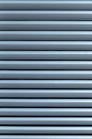Light through the wooden shutters and blinds. Soft home decor. Retro style. Luxury white indoor plantation shutters, closed shutters Foto de archivo - 152350000