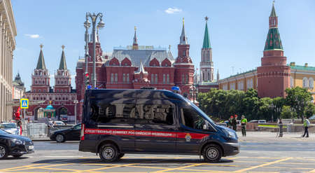MOSCOW, RUSSIA - JULY 23, 2020: Police car of the Investigative Committee of Russia in front of the Kremlin towers of Red Square in the center of Moscow. Excellent Crime Illustrative Editorial