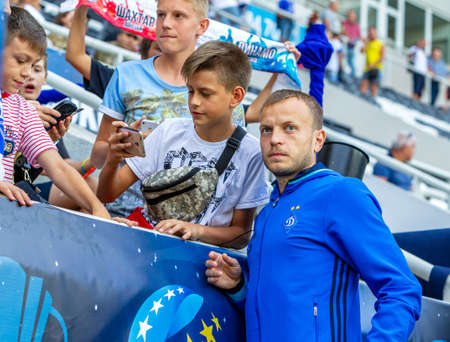 ODESSA, UKRAINE - 07/15/2018: Players of FC Dynamo Kiev on the bench before the start of the UEFA Cup match against FC Shakhtar Donetsk. Footballers on the bench