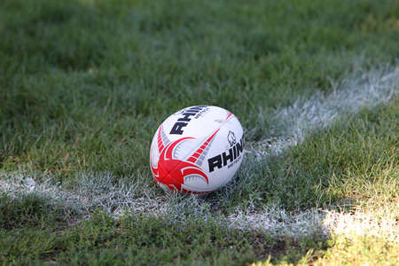 ODESSA, UKRAINE - SEPTEMBER 12, 2020: The official ball of the European Rugby Championship Gilbert on a sports field with green grass for playing rugby. Focus on the front of ball Editorial