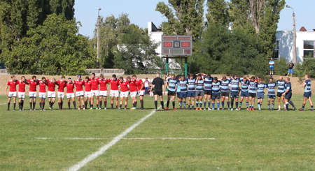 ODESSA, UKRAINE - SEPTEMBER 12, 2020: Final games of strongest rugby-7 teams in Ukrainian championship. Rugby ball on field. Rugby match is tough fight for ball. Athletes team players on field Editorial