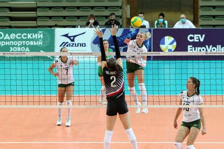 ODESSA, UKRAINE-09/30/2020. Women's emotional Volleyball. Champion of Ukraine KHIMIK Yuzhny (white) and PROMETEY (KAMENSKOYE) black. Joyful emotions of team after victory. Women's sports game Éditoriale