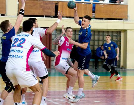 ODESSA, UKRAINE - April 23, 2021: Handball. Federation of Men's Handball of Ukraine. Match Odessa - Motor Sich, Zaporozhye - white. Action during men's handball game. Hard attacking with ball