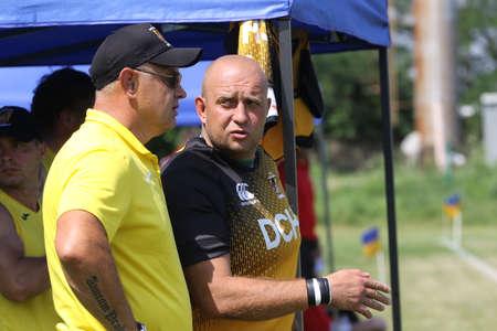 Odessa, Ukraine - June 23, 2021: Odessa national team CREDO (red) - OLYMP Kharkiv (yellow) rugby-7. Valeriy Kochanov - head coach of OLYMP rugby club - Kharkiv - coach of national team of Ukraine