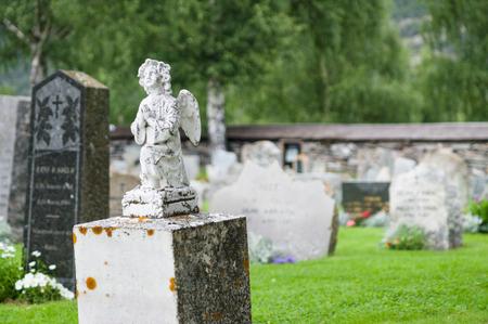 angel cemetery: Gravestone statue of praying angel at cemetery