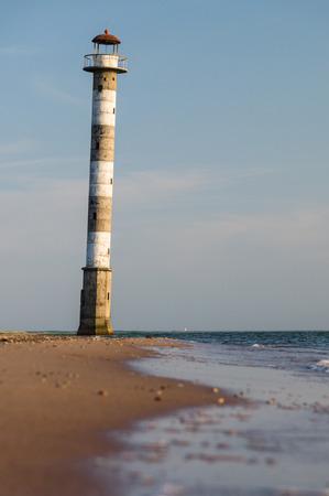 awry: Abandoned falling lighthouse on the beach of Saaremaa island, Estonia Stock Photo