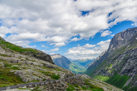 Cloudscape view on a summer valley and Trollstigen mountain road, Norway photo