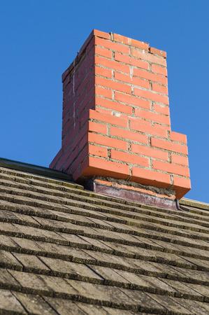 redbrick: Redbrick chimney and vintage wooden plank roof Stock Photo