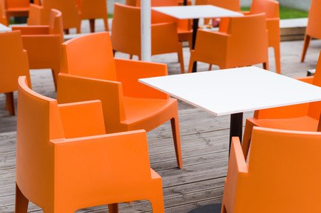 orange chairs: Modern furniture outdoor cafe terrace with orange chairs
