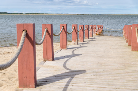 rope barrier: Plank footpath and fence boundary rope barrier on the beach Stock Photo