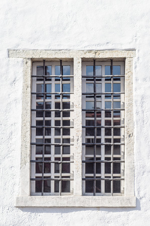 Medieval style window with iron grid photo