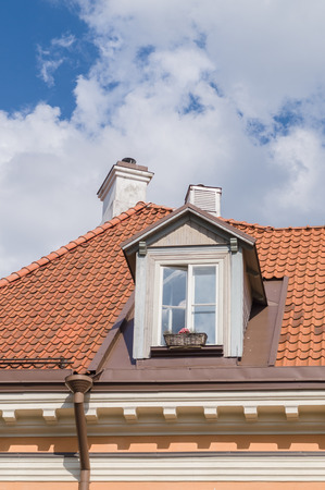mansard: Authentic mansard window in a old style tiled roof