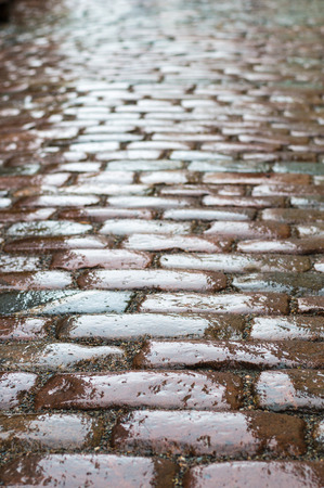 cobblestone road: Wet vintage cobblestone road vertical view