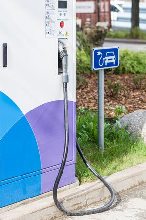 plug electric: Electric car charging station closeup