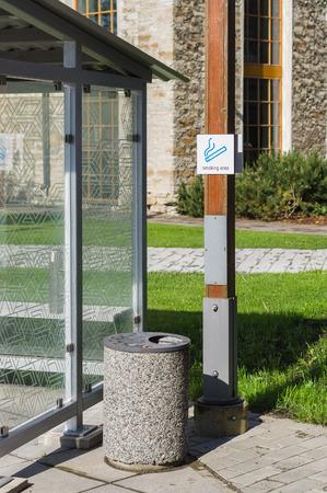 Outdoor smoking area zone, cabin and litter-bin