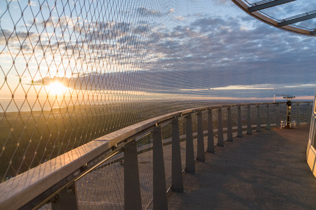 Coin operated panoramic telescope on TV tower sunset view