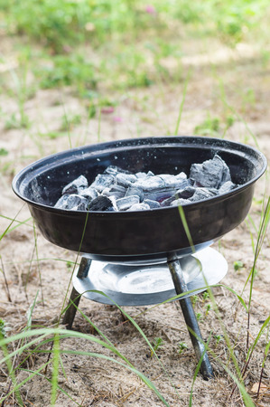 smoldering: Small grill with smoldering charcoal Stock Photo