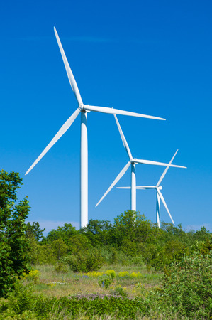 nature protection: Wind turbines generating electricity. Nature protection concept Stock Photo