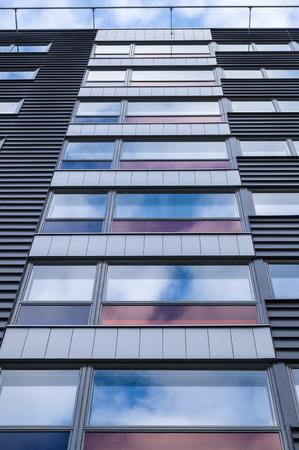 sky reflection: Modern business building facade, sky reflection on window glass