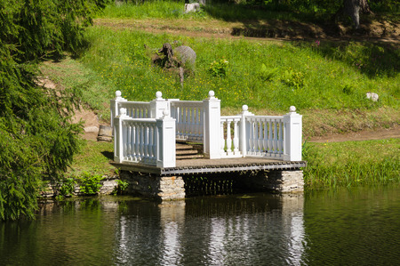 gangway: Vintage style pond jetty, gangway in summer park Stock Photo