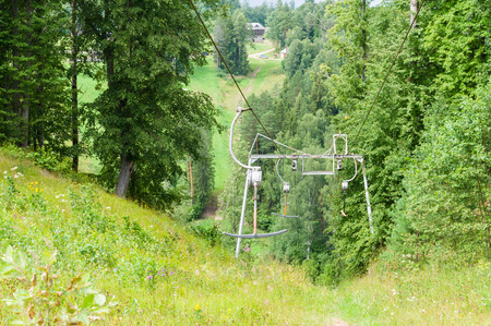 inoperative: Inoperative rusty ski lift in woodland on summer