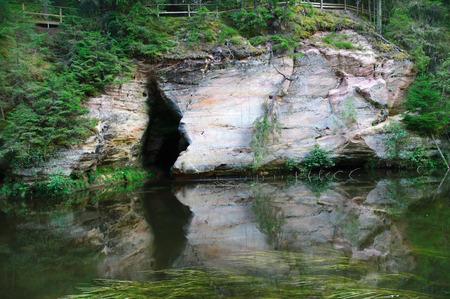 scarp: Cave in sandstone outcrops of Ahja river, Estonia