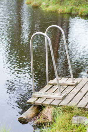 wooden railings: Small wooden jetty with railings to the muskeg