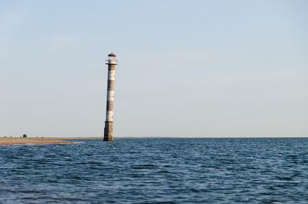 awry: Falling Kiipsaare lighthouse in water of Baltic sea, Estonia