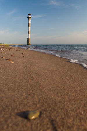 surface view: Tilted Kiipsaare lighthouse from beach surface view, Saaremaa island, Estonia
