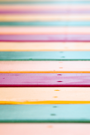versicolor: Yellow, green and red painted planks, striped versicolor vivid background