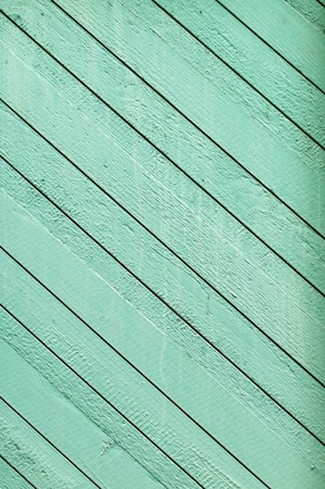 lopsided: Wooden plank wall painted green, diagonal pattern Stock Photo