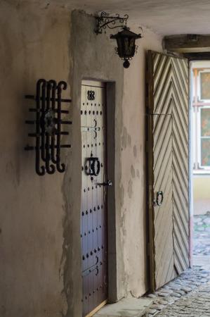 ornate door: Ornate door and lantern in passageway