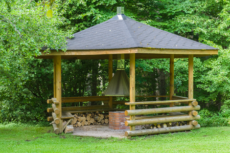 outdoor fireplace: Small wooden grill house in the forest Stock Photo