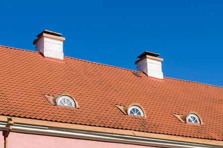 mansard: Retro style tiled roof with chimneys and mansard windows