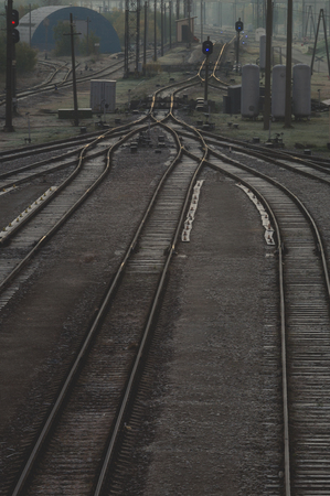 railway points: Railroad tracks at train station, transportation infrastructure