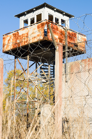 fence wire: Abandoned watch-tower and prison fence wire barbs