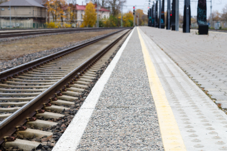 diminishing perspective: Blurred image of railway track and rail platform, diminishing perspective Stock Photo