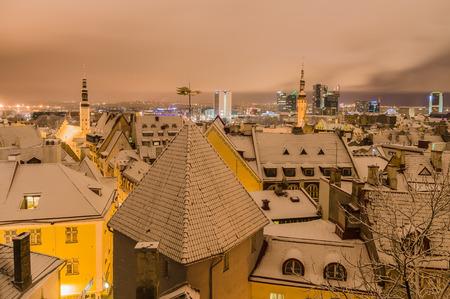 snowbound: Winter time view on snowbound old town and modern city at night, Tallinn, Estonia