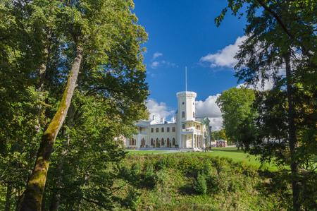 joa: KEILA-JOA, ESTONIA - SEPTEMBER 27, 2015: Keila-Joa manor Schloss Fall, neo-gothic style building of 19th century standing on hillside under blue sky.