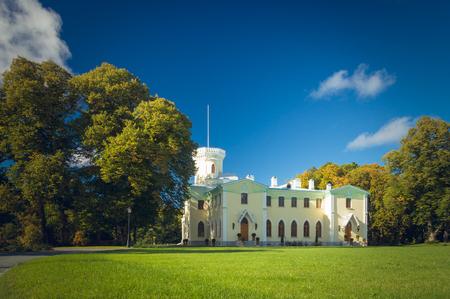 joa: KEILA-JOA, ESTONIA - SEPTEMBER 27, 2015: Keila-Joa manor Schloss Fall, neo-gothic style building of 19th century. Autumnal view under blue sky.