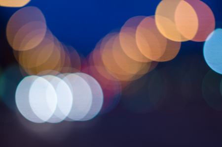 vintage design: Night city blurred bokeh lights colorful background Stock Photo