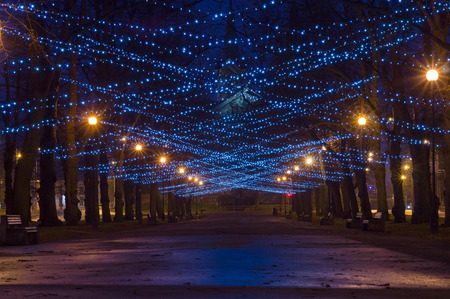 City boulevard decorated with New Year and Christmas illumination Banco de Imagens