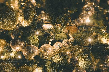glass christmas tree ornament: Decorated and illuminated christmas tree, vintage toning
