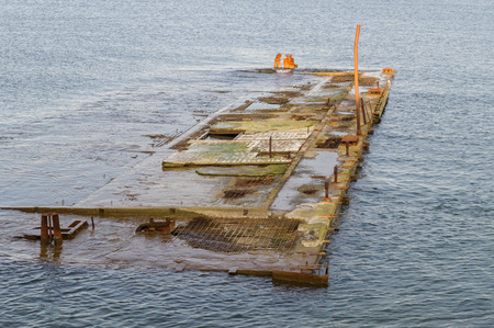 submerged: Abandoned quay submerged in water